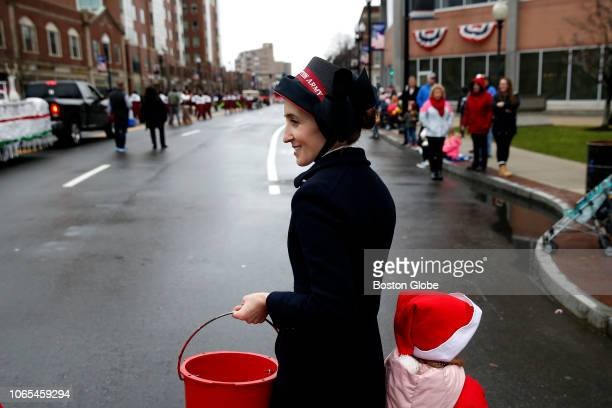 A woman gives out candy on behalf of the Salvation Army during the 66th annual Christmas Parade in Quincy MA on Nov 25 2018
