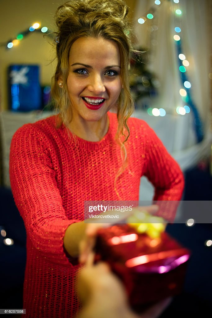 Woman giving a gift. Happy birthday. Happy New Year. : Foto de stock