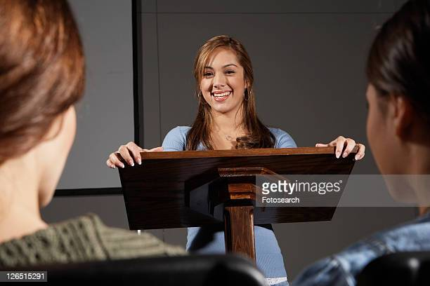 Woman giving a presentation to two students