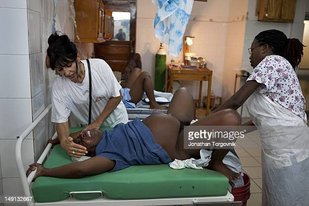 A woman giving birth at the Doctors Without Borders/Medecins Sans Frontieres Choscal Hospital in Cite Soleil January 2011