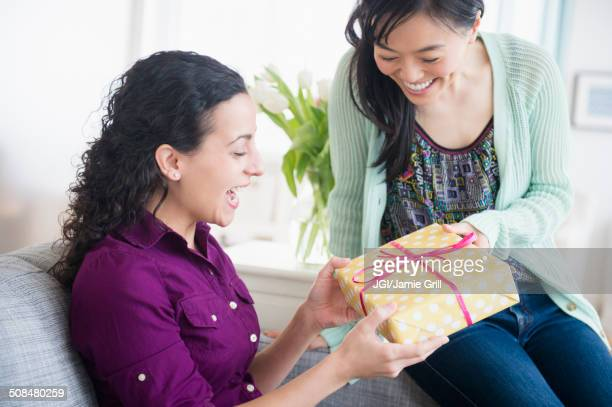 Woman giving friend birthday present