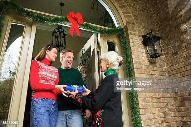 Woman giving gift to couple