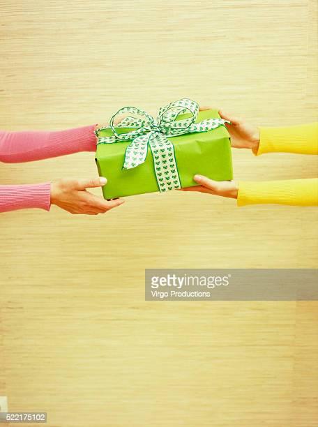 Woman Giving Green Present