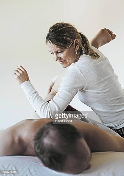 Woman giving healing massage.