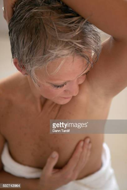 Woman Giving Herself a Breast Examination