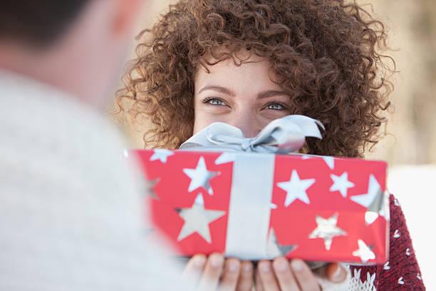 Woman giving man gift