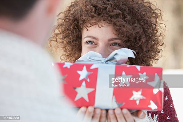 Woman giving man gift