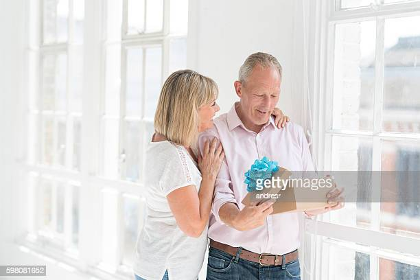 Woman giving present to her husband