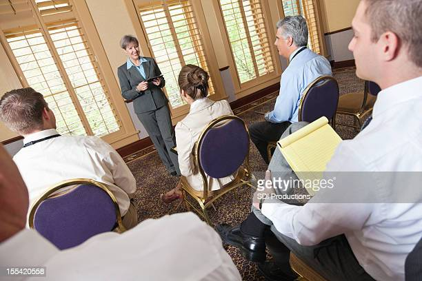 Woman giving presentation at a business meeting or conference
