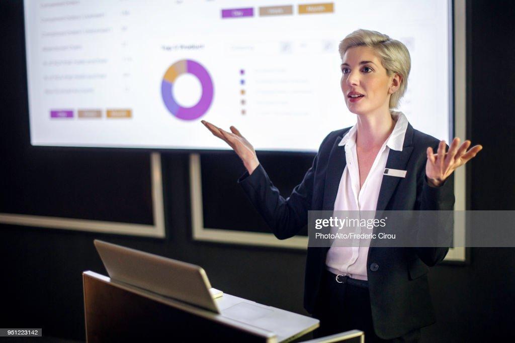 Woman giving presentation : Stock Photo