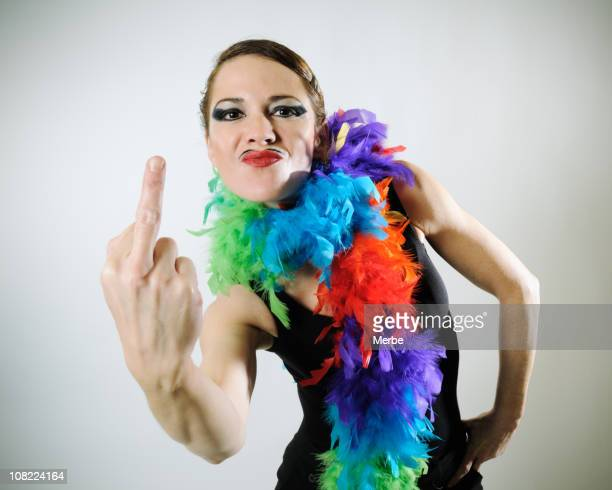 woman giving rude gesture - middle finger funny stock photos and pictures