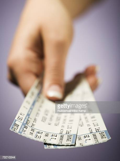 Woman giving tickets