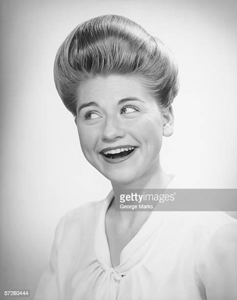 Woman glancing, posing in studio, (B&W), close-up, portrait