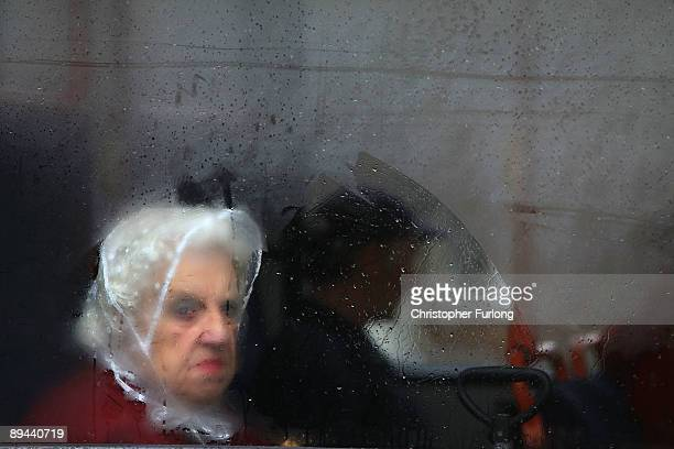 A woman gloomingly looks out from the steamed up windows of a bus as incessant rain continues to fall on July 29 2009 in Walsall United Kingdom The...