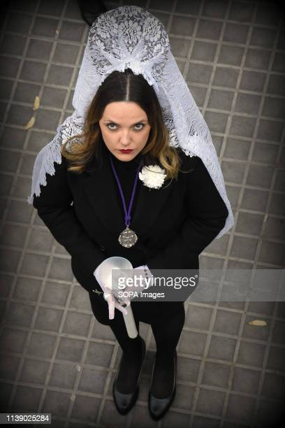 L´HOSPITALET CATALONIA SPAIN A woman Godmother of the brotherhood 15 1 seen with a candle during the parade Easter Parade 2019 Hospitalet A parade...