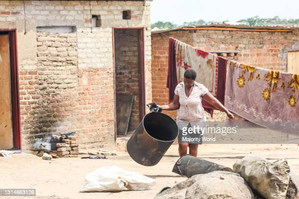 Woman goes about her house chores in Hopley Harare. Hopley is one of the areas with poor living conditions. Zimbabwe.