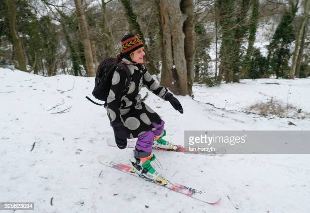 A woman goes skiing through woods on March 1 2018 in SaltburnByTheSea United Kingdom Freezing weather conditions dubbed the Beast from the East...