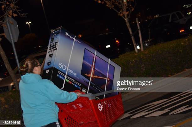 CONTENT] A woman goes to her car with a 50 large screen TV in her shopping cart on Thanksgiving during an early Black Friday sale It was later...