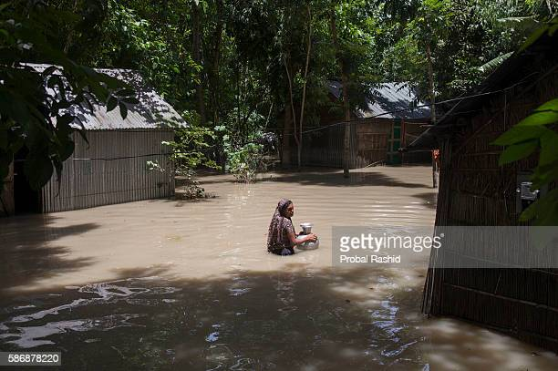 JAMALPUR MYMENSINGH BANGLADESH A woman going back to her home after collecting fresh water According to the Bangladesh Disaster Management Bureau...
