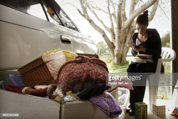 woman going through emotional memories - rafael ben ari stock-fotos und bilder