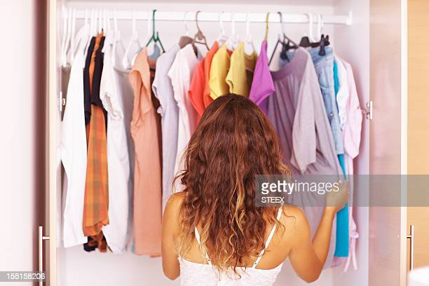 Woman going through her clothes