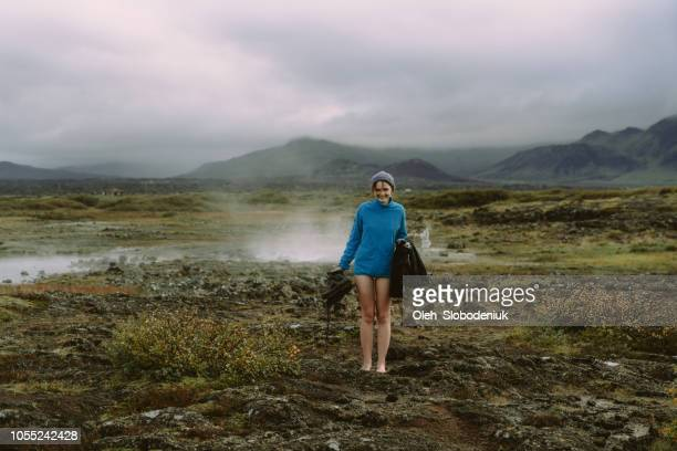 woman going to natural geothermal pool in iceland - geologia foto e immagini stock