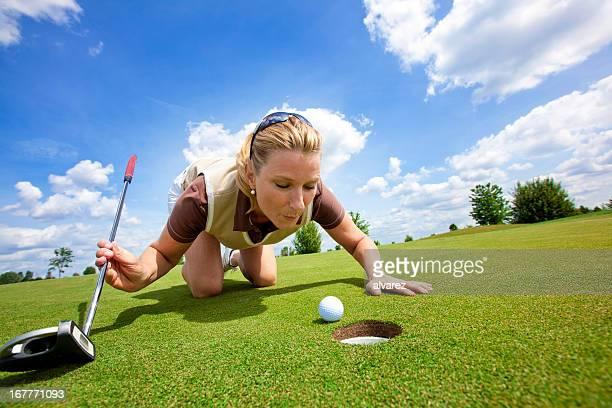 Woman Golfer cheating