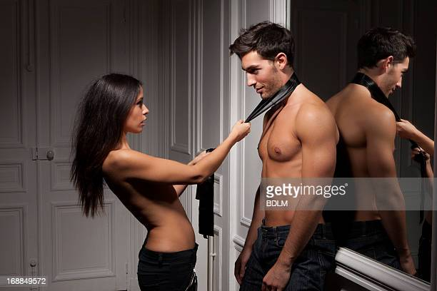 Woman grabbing boyfriend by tie