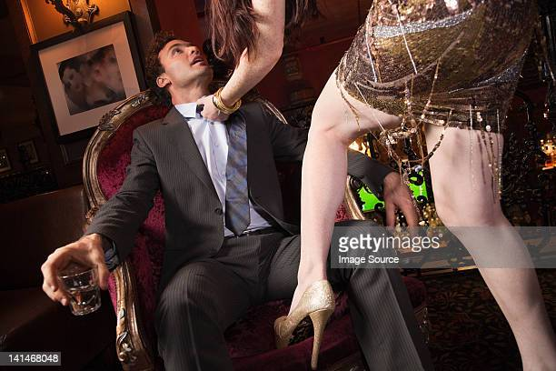 woman grabbing businessman in bar - women dominating men stock photos and pictures