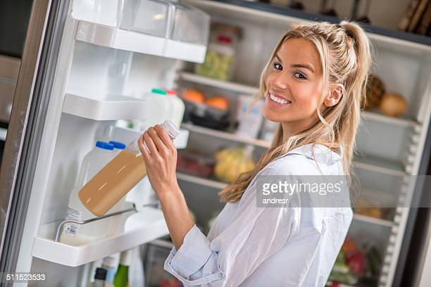 Woman grabbing something from the fridge