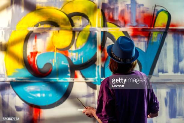 Woman Graffiti Painter Is Drawing