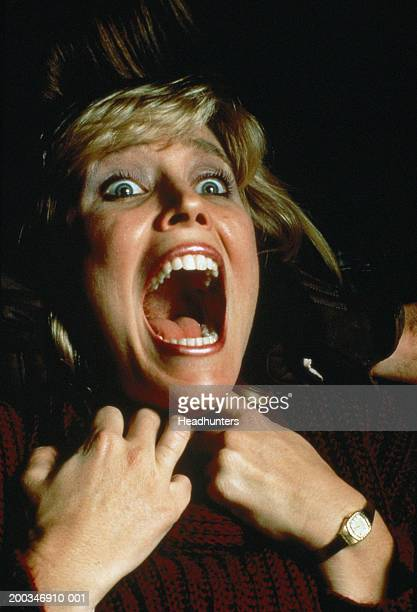 woman grasping throat, mouth wide open - women being strangled stock photos and pictures