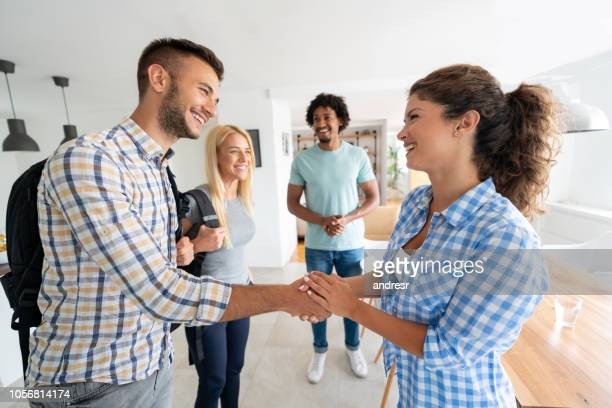 Woman greeting a new house mate at home