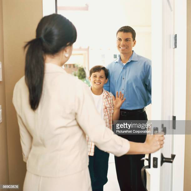 Woman greeting man and son