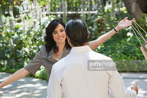 Woman greeting returning boyfriend