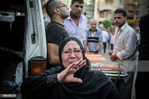 CONTENT] A woman grieve at Iman mosque which was turned into a makeshift morgue following the violent dispersal of Rabaa Adaweya square and the death...