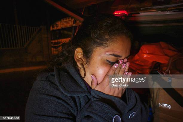 A woman grieves after witnessing a traumatic scene January 17 2014 in Guatemala City Guatemala The bomberos voluntarios are a volunteer fire fighting...