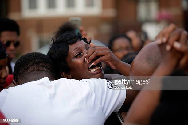A woman grieves as she attends a vigil for Africa Bass who was killed as she walked through her apartment complex July 27 2016 in Chicago Illinois...