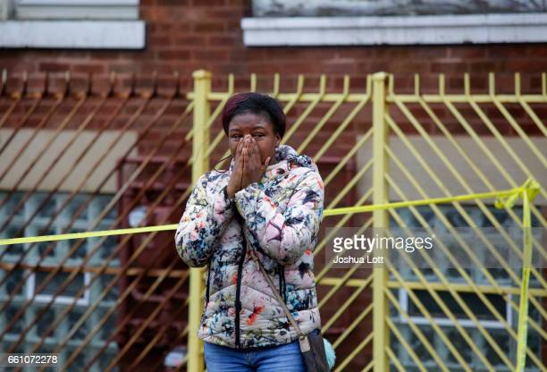 A woman grieves as she reacts to a shooting that left four people dead at a restaurant in the 2700 block of East 75th Street on March 30 2017 in...