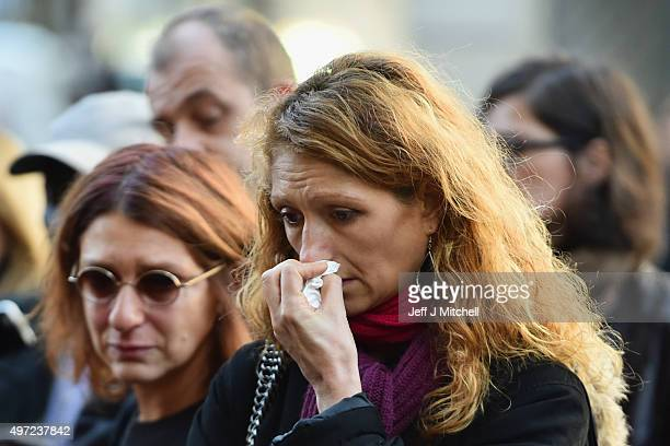 A woman grieves as she views flowers placed at the La Belle Equipe restaurant on Rue de Charonne following Fridays terrorist attack on November 15...