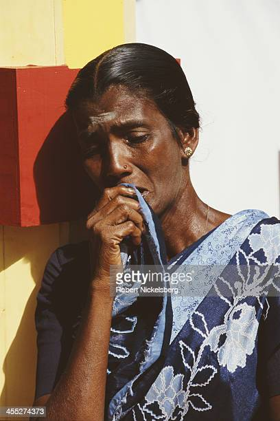 A woman grieves at a shrine during a week long memorial honoring Tamil separatist Liberation Tigers of Tamil Eelam members killed during the conflict...
