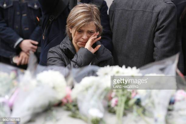 A woman grieves by a makeshift memorial for victims of the van attack in Toronto Ontario on April 24 2018 A van driver who ran over 10 people when he...