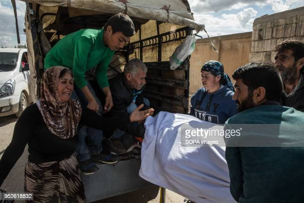 A woman grieves for her husband who died from a heart attack due to lack of medicine and aid in Ahras where an estimated 50000 displaced refugees are...