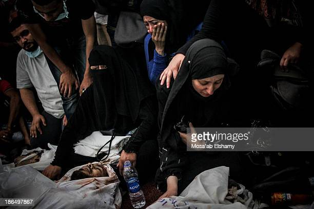 CONTENT] A woman grieves next to dead bodies laid at Iman mosque which was turned into a makeshift morgue following the violent dispersal of Rabaa...