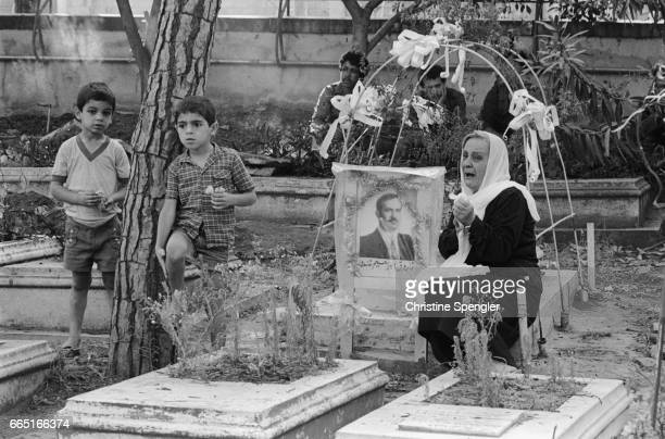A woman grieves over a deceased loved one at the PLO's martyrs cemetery in the Muslim sector of West Beirut Over a month of bombings have taken place...