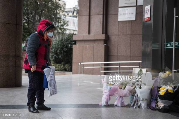 A woman grieves while paying tribute to Dr Li Wenliang at Li's hospital in Wuhan in central China's Hubei province on Februsry 7 2020 in Wuhan China...