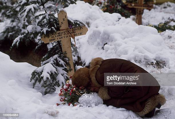 A woman grieving in a Bucharest cemetery shortly after the Romanian Revolution 1990