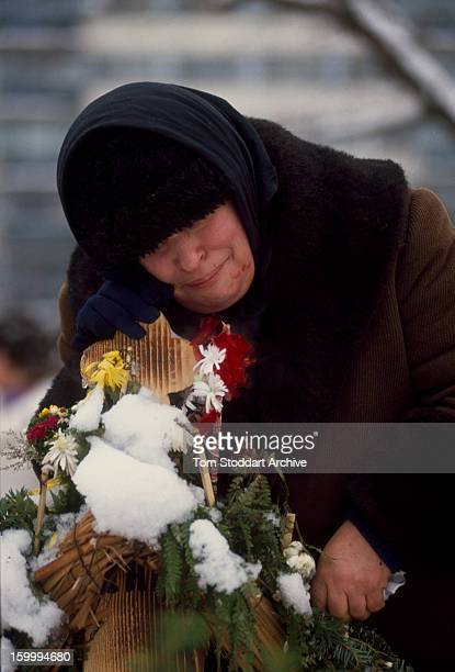 A woman grieving in Bucharest cemetery shortly after the Romanian Revolution 1990