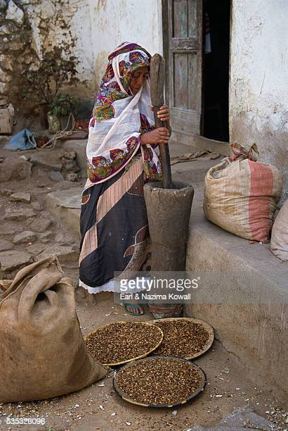 Woman Grinding Coffee Beans