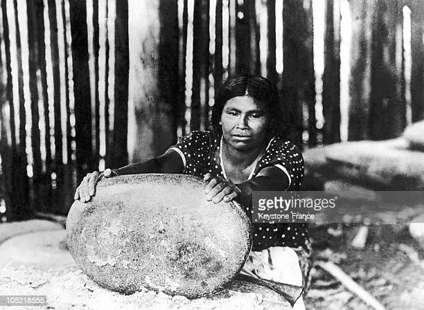 Woman Grinding Corn To Make Flour The Old Way With A Large Stone Which Smashes The Kernels In Costa Rica Between Approximately 1920 And 1940